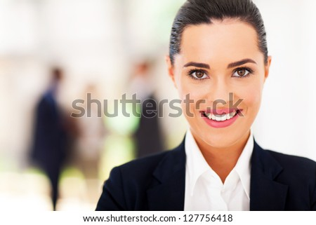 attractive businesswoman face closeup - stock photo