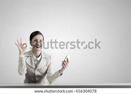 Attractive businesswoman having mobile conversation .  Mixed media - stock photo
