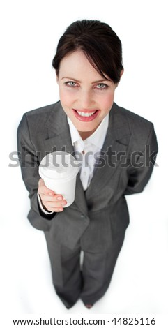 Attractive businesswoman holding a drinking cup isolated on a white background