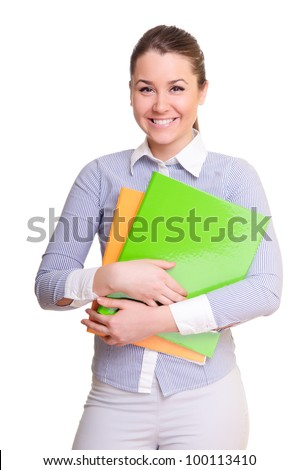 attractive businesswoman holding folder in hands. positively smiling. isolated on a white background
