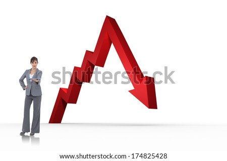 Attractive businesswoman holding tablet pc against red arrow pointing down - stock photo