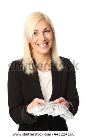 Attractive businesswoman in a black suit and white shirt, holding alot of 100 dollar bills, a big smile on her face. White background. - stock photo