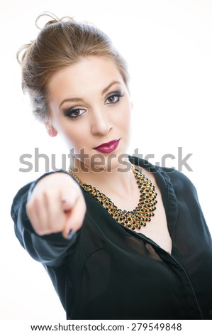 Attractive businesswoman pointing with her finger - stock photo