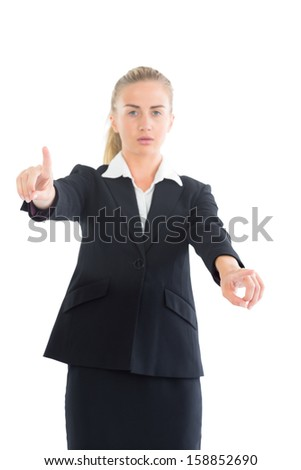 Attractive businesswoman pointing with her hands on white background