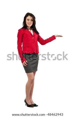 Attractive businesswoman showing with her hand to the copyspace