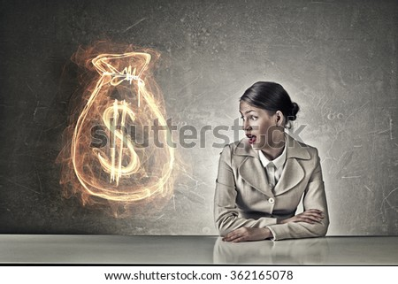 Attractive businesswoman sitting at table - stock photo