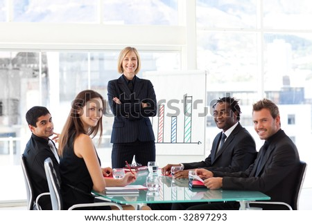 Attractive businesswoman smiling at the camera in a meeting