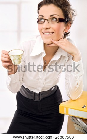 Attractive businesswoman thinking
