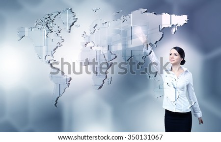 Attractive businesswoman touching with finger virtual interface screen