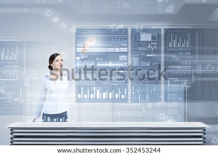 Attractive businesswoman touching with finger virtual interface screen - stock photo