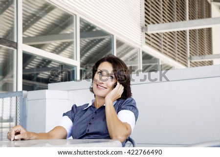 Attractive businesswoman using mobile phone - stock photo