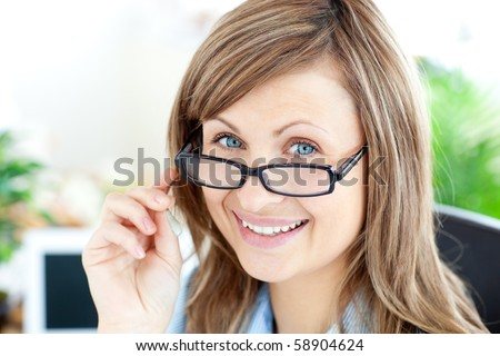Attractive businesswoman wearing glasses smiling at the camera in the office