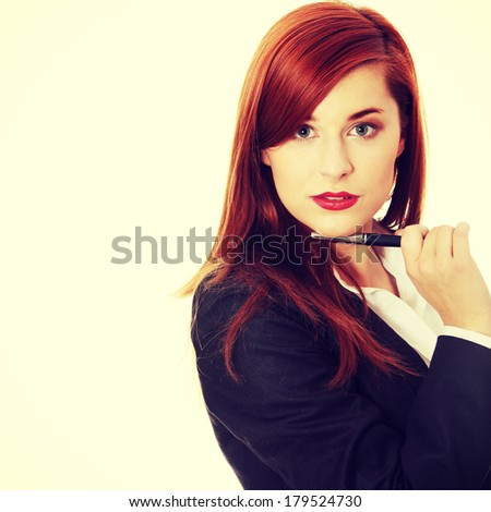 Attractive businesswoman with a pen  - stock photo