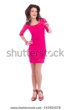Attractive carefree young lady dressing pink dress posing on white background and showing finger up - stock photo