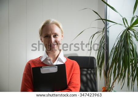 Attractive caucasian blonde business woman working in the office