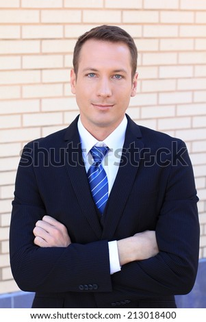 Attractive Caucasian Business Man Wearing a White Shirt Arms Crossed and Confident - stock photo