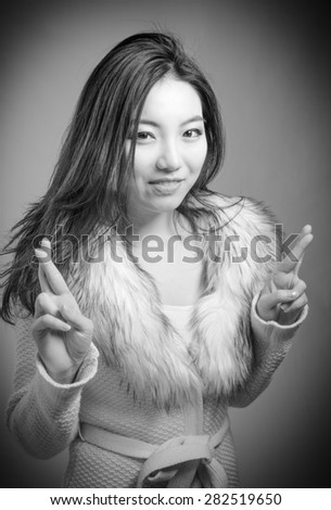 Attractive caucasian business woman in her 30s shot in studio isolated on a white background, black and white image in her 30s shot in studio isolated on a grey background, black and white image - stock photo