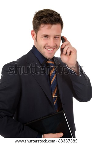 Attractive caucasian businessman holding a laptop and talking by phone . Studio shot. White background. - stock photo