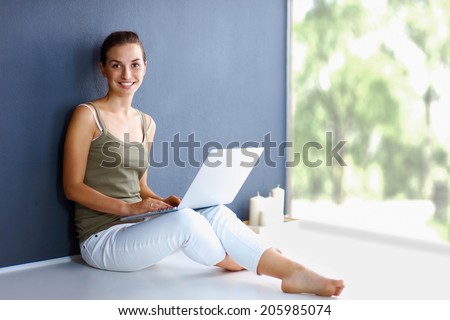 Attractive caucasian girl sitting on floor