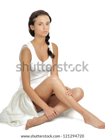 Attractive caucasian girl sitting on floor , Isolated on white background.