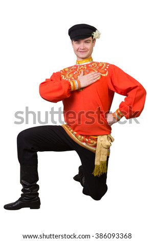 attractive caucasian guy dancing in folk costume isolated on white - stock photo