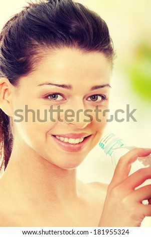 Attractive caucasian woman drinking water from bottle  - stock photo