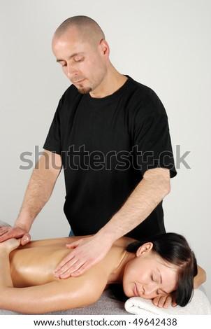 Attractive caucasian woman getting massaged - stock photo