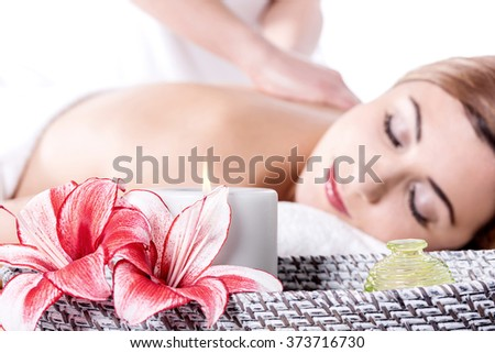 Attractive caucasian woman lying down and getting massage - stock photo