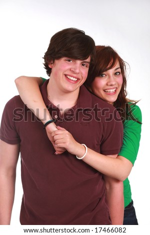 attractive causasian teen couple hugging and smiling