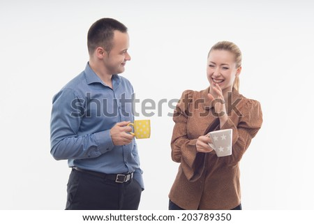 Attractive cheerful smiling colleagues holding cups of coffee isolated on white - stock photo