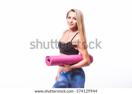 Attractive cheerful young sportswoman holding yoga mat isolated over white background - stock photo