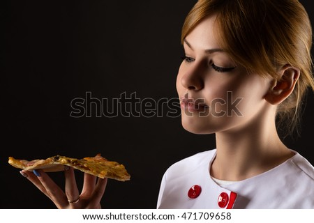 attractive chef looking slice of pizza