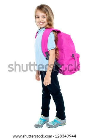 Attractive child ready to attend school. Isolated against white background. - stock photo