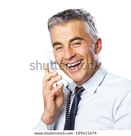 Attractive confident businessman talking on the phone on white background. - stock photo