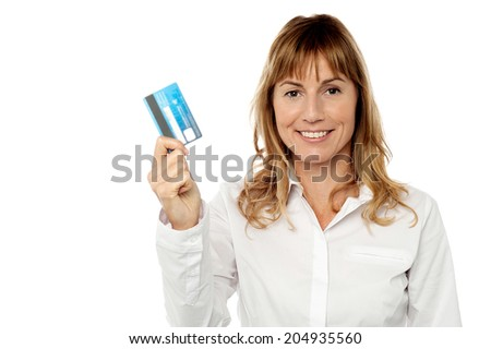 Attractive corporate woman showing atm card - stock photo