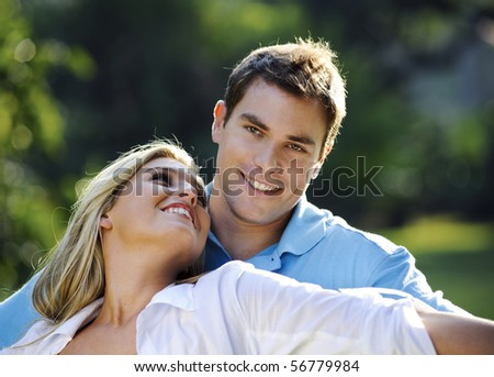 Attractive couple are happy with each other in the park - stock photo