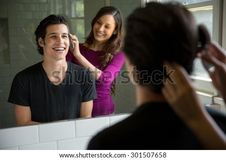 Attractive couple beautiful hair woman loves mans full head of healthy haircut - stock photo