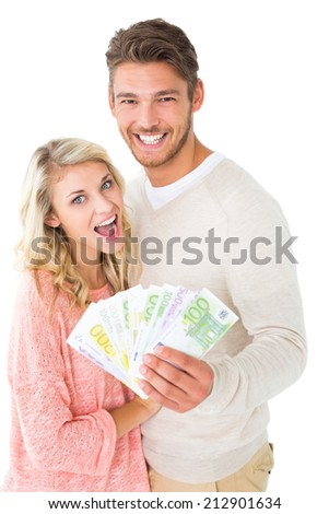 Attractive couple flashing their cash on white background - stock photo