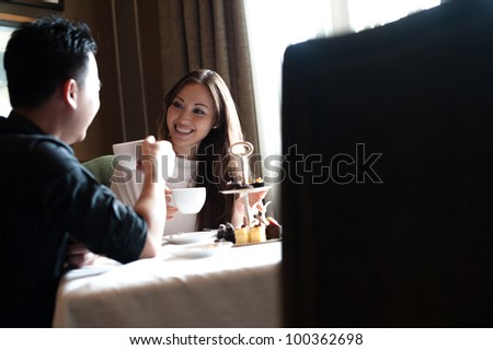 Attractive Couple in Cafe - stock photo