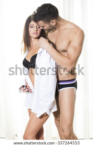 Attractive couple in embrace