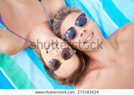Attractive couple in eyeglasses enjoying summer vacations - stock photo