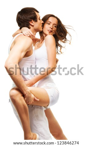 Attractive couple in intimate dance hugging and kissing - stock photo