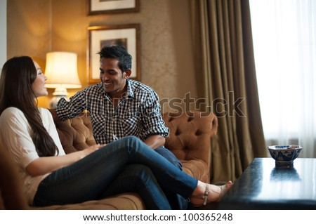 Attractive Couple in Lounge - stock photo