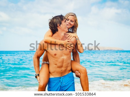 Attractive Couple on Beautiful Beach - stock photo