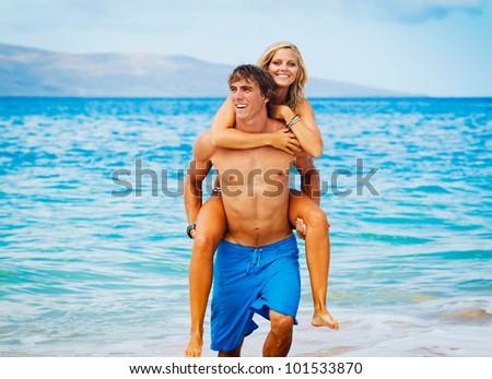 Attractive Couple on Beautiful Beach - stock photo