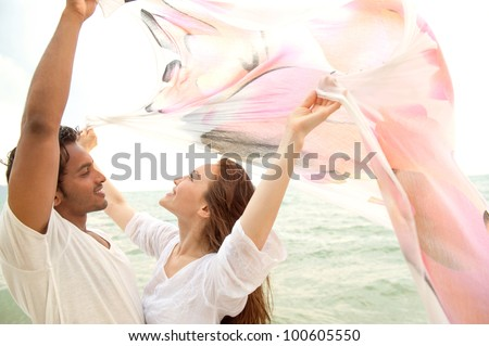 Attractive Couple on the Beach - stock photo