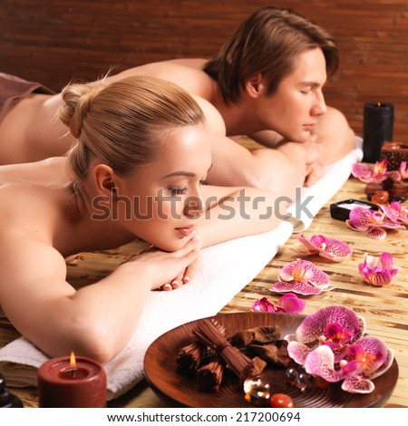 Attractive couple relax at the spa salon. Beauty treatment concept. - stock photo
