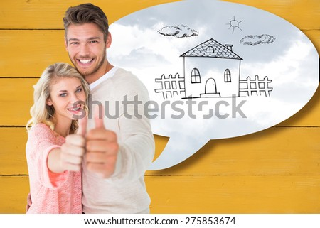 Attractive couple showing thumbs up to camera against grey cloudy sky - stock photo
