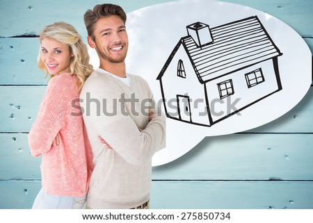 Attractive couple smiling with arms crossed against blue sky - stock photo
