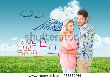 Attractive couple turning and smiling at camera against blue sky over green field - stock photo